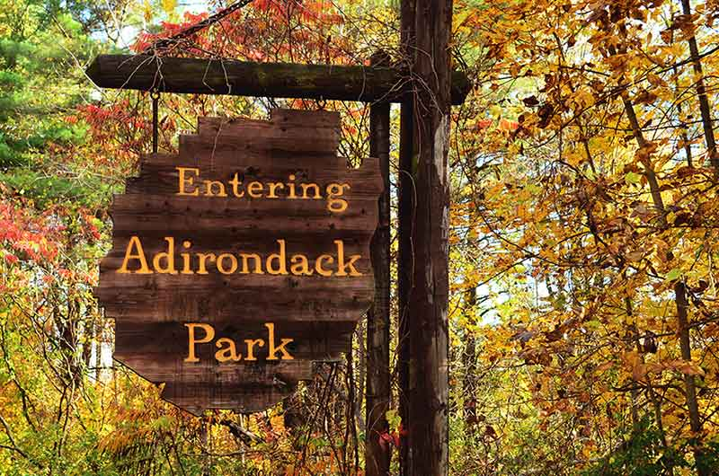 Entering Adirondack Park Sign against fall foliage