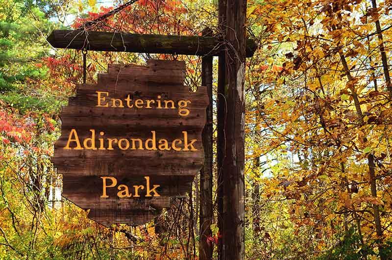 Entering Adirondack Park Sign against fall foliage